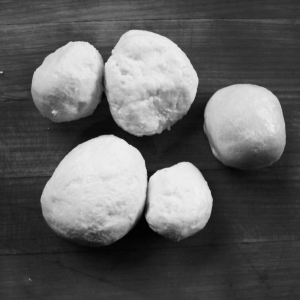 Balls of Mozzarella right after cold treating them